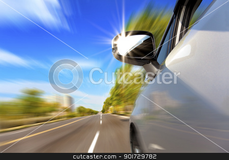 car on the road with motion blur and sunlight in the mirror stock photo, car on the road with motion blur and sunlight in the mirror by tomwang