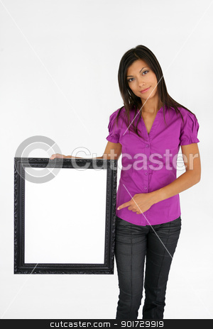 woman pointing at a picture frame stock photo, woman pointing at a picture frame by photography33