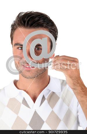 Man holding metallic at symbol over eye stock photo, Man holding metallic at symbol over eye by photography33
