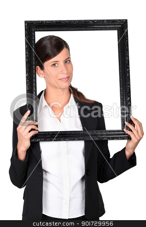 Woman holding empty picture frame stock photo, Woman holding empty picture frame by photography33