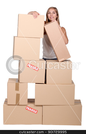 Young woman with a pile of cardboard boxes marked fragile stock photo, Young woman with a pile of cardboard boxes marked fragile by photography33