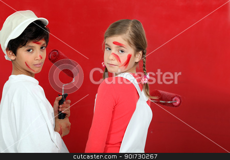 Kids painting a wall in red stock photo, Kids painting a wall in red by photography33