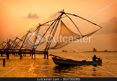 Sunset over Chinese Fishing nets in Cochin stock photo, Sunset over Chinese Fishing nets and boat in Cochin (Kochi), Kerala, India. by johnnychaos