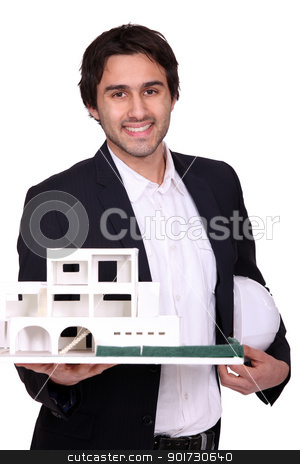 Architect holding scale model of housing stock photo, Architect holding scale model of housing by photography33