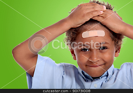 coloured little boy with plaster on his forehead against fluorescent green background stock photo, coloured little boy with plaster on his forehead against fluorescent green background by photography33