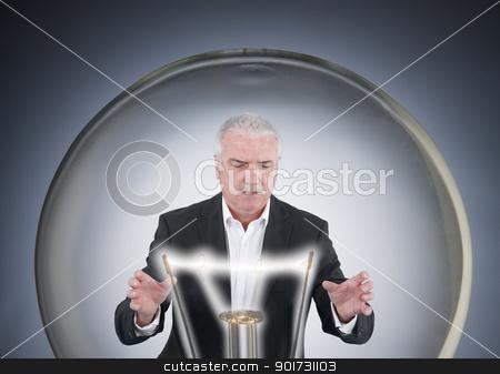 Businessman inside a light bulb stock photo, Businessman inside a light bulb by photography33