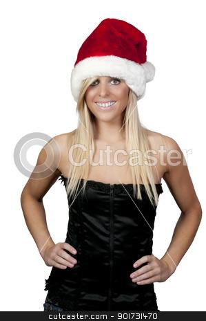 Christmas Girl stock photo, A beautiful young woman wearing a Santa hat by Robert Byron