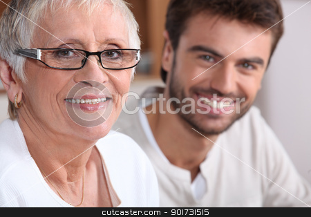 Senior woman in glasses with young man stock photo, Senior woman in glasses with young man by photography33