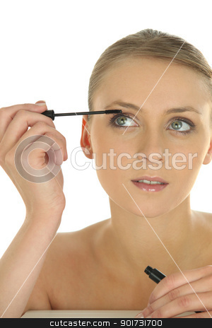 Woman applying makeup stock photo, Woman applying makeup by photography33
