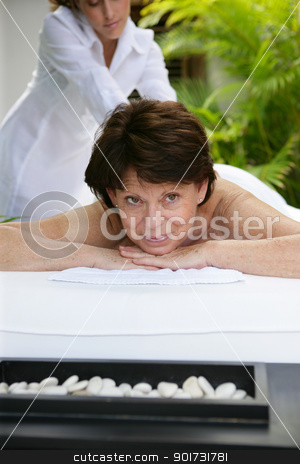 Woman receiving a massage at a day spa stock photo, Woman receiving a massage at a day spa by photography33