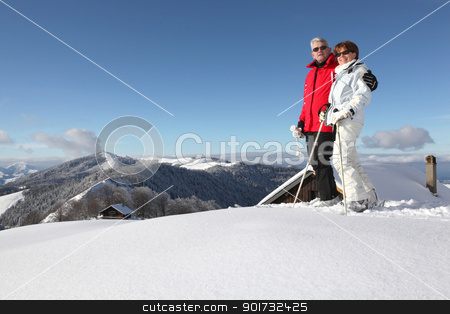 Middle-aged couple skiing stock photo, Middle-aged couple skiing by photography33