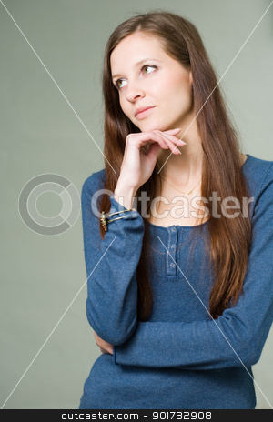 Pretty young student girl pondering. stock photo, Portrait of a pretty young brunette student girl pondering. by exvivo