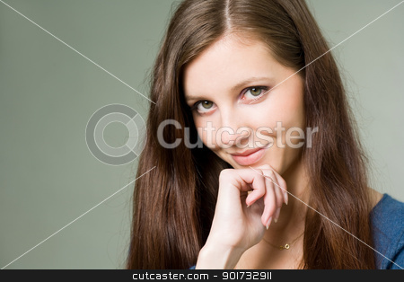 Young brunette woman thinking. stock photo, Portrait of a beautiful young brunette woman with thinking expression. by exvivo