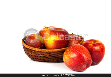 Apples in basket stock photo, Red and yellow apples in wooden basket over white background by borojoint