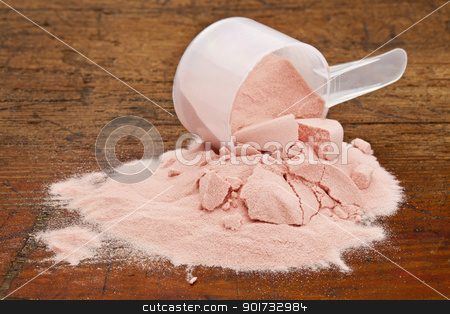 pomegranate fruit powder stock photo, a measuring cup of organic freeze-dried pomegranate fruit powder on a grunge wooden background by Marek Uliasz