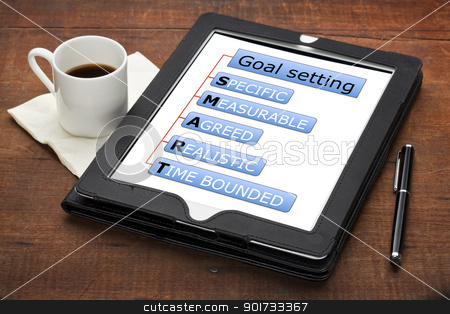 smart goal setting concept  stock photo, SMART (specific, measurable, agreed, realistic, time bounded) goal setting concept - a diagram on a tablet computer with stylus pen and espresso coffee cup against grunge scratched wooden table by Marek Uliasz