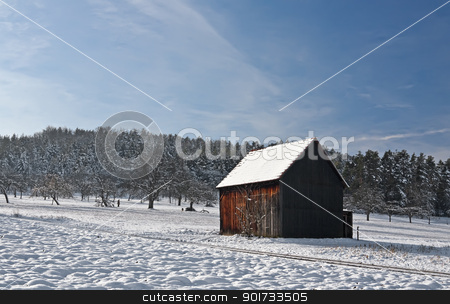 Cabin in Winter stock photo, This image shows a cabin in winter by kirschner