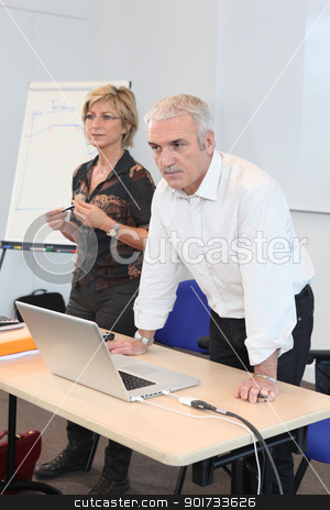 Teacher in classroom with assistant stock photo, Teacher in classroom with assistant by photography33