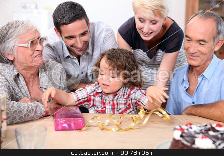 Parents and grandparents with a boy on his birthday stock photo, Parents and grandparents with a boy on his birthday by photography33