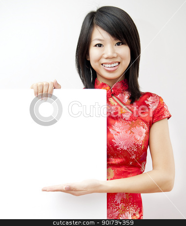 Oriental girl stock photo, A smiling Oriental girl holding blank sign on grey background by szefei