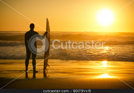 A surfer watching the waves stock photo, A surfer watching the waves at sunset in Portugal. by Homydesign