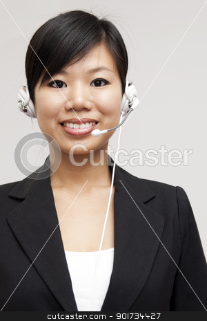 Customer Representative stock photo, Friendly Customer Representative with headset smiling during a telephone conversation by szefei
