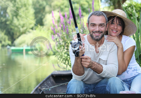Romantic couple fishing on the river stock photo, Romantic couple fishing on the river by photography33
