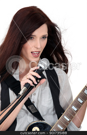 Woman singing and playing guitar stock photo, Woman singing and playing guitar by photography33