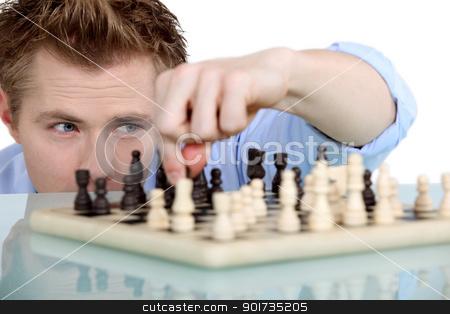 Man playing chess alone stock photo, Man playing chess alone by photography33