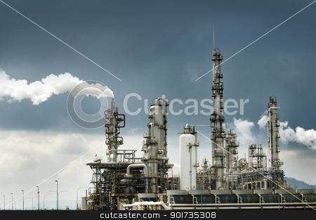 Oil refinery with smoke stock photo, Oil refinery with smoke against moody sky by szefei