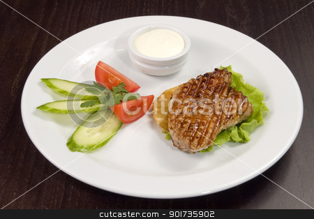 Piece of fried meat with vegetables. stock photo, Piece of fried meat with vegetables on a white plate. by Yury Ponomarev