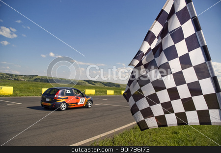 Checkered flag. stock photo, Auto racing checkered flag on a background of the  blue sky. by Yury Ponomarev