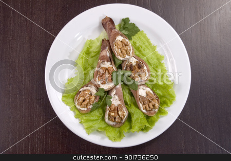 Tongue stuffed with a nut. stock photo, Tongue stuffed with a nut on a white plate. by Yury Ponomarev