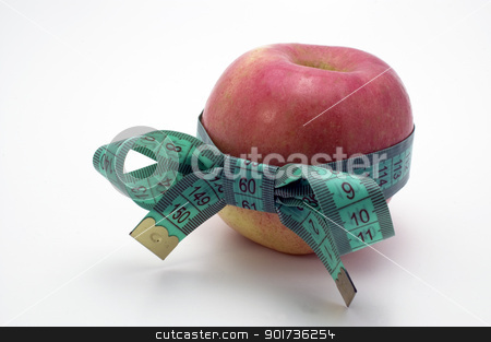 Symbol of diet and healthy eating. stock photo, Red Apple with measuring tape. by Yury Ponomarev
