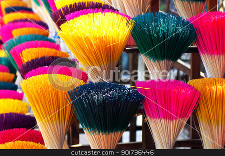 Colorful incense or joss sticks for buddhist prayers stock photo, Colorful incense or joss sticks for buddhist prayers in Vietnam  by John Young