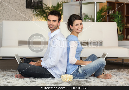Couple sitting with laptop computers stock photo, Couple sitting with laptop computers by photography33