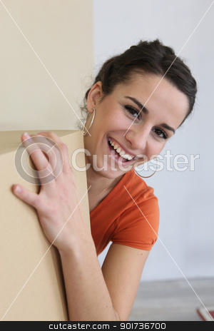 Woman moving belongings stock photo, Woman moving belongings by photography33