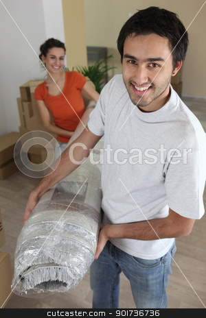 Couple carrying carpet stock photo, Couple carrying carpet by photography33