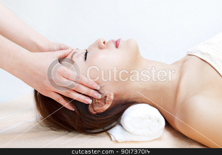 Facial massage stock photo, Beauty and Spa - Asian Girl having a massage on her head by szefei