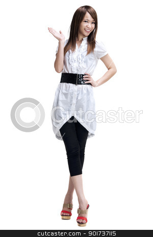 Woman presenting product isolated on white. stock photo, Full length of happy cheerful beautiful Japanese Asian young woman holding her hand out and showing copy space for your product. by szefei