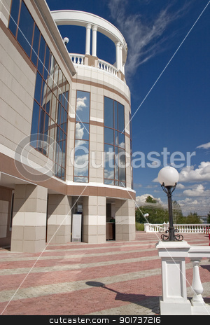 Balcony with white columns. stock photo, Glass facade and balcony with columns. by Yury Ponomarev