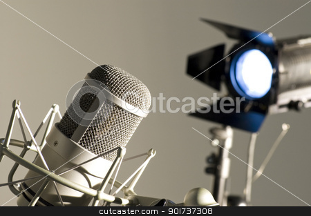 Microphone in studio. stock photo, Microphone in studio on a light background. by Yury Ponomarev