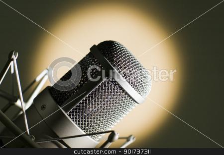 Microphone in studio. stock photo, Microphone in studio. Yellow light. by Yury Ponomarev