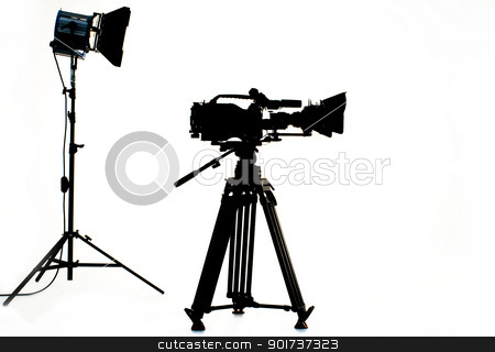TV the camera in studio. stock photo, Searchlight and silhouette of the chamber. by Yury Ponomarev