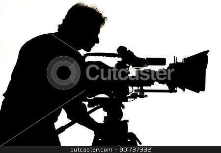 Studio light on location for movie scene. stock photo, Cameraman silhouette and cameras. by Yury Ponomarev