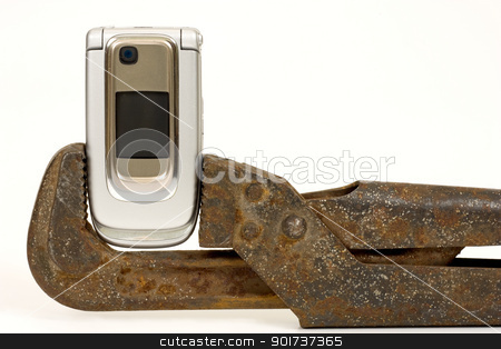 Spanner and telephone. stock photo, Old rusty nut key and modern telephone on a white background. by Yury Ponomarev