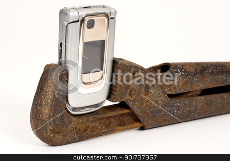 Spanner and telephone. stock photo, Old rusty spanner and modern telephone. by Yury Ponomarev