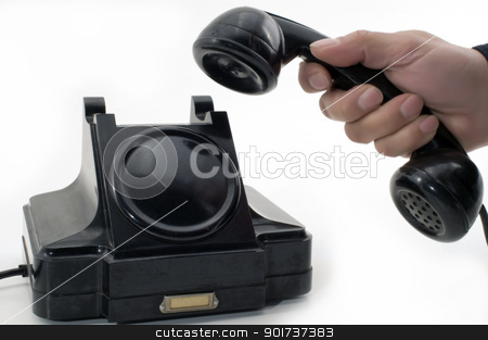 Old Phone. stock photo, Telephone receiver in hand, isolated on white background. by Yury Ponomarev