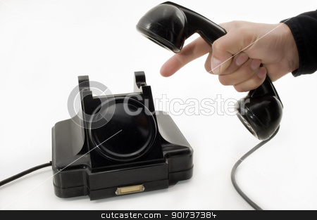 Old Phone stock photo, Telephone receiver in hand, isolated on white background. by Yury Ponomarev
