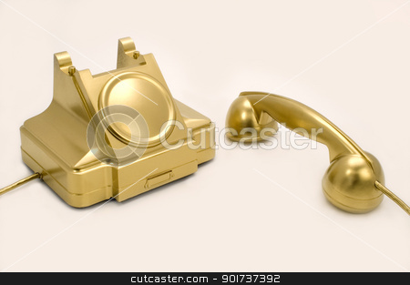 The gold telephone. stock photo, The telephone of gold colour on a white background. by Yury Ponomarev
